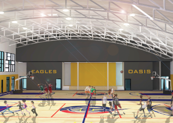 Image of Oasis International School's gym, featuring two full sized basketball courts and a weight room.