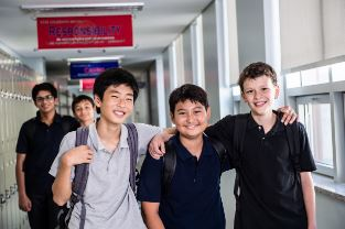 Image of a group of close friends in a Middle School hallway
